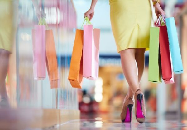 rear-view-of-woman-walking-through-the-mall_1098-2469